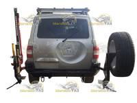 Бампер задний на УАЗ Патриот ЭВОЛЮЦИЯ с кронштейном запаски, с держателем Hi-Jack, топора и лопаты, с буксирными петлями
